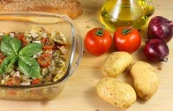 Baked potatoes with tomato and oregano Royalty Free Stock Photo