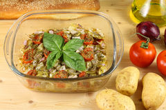 Baked potatoes with tomato and oregano Royalty Free Stock Images
