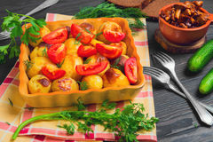 Baked potatoes with tomatoes Stock Images