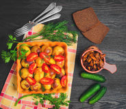Baked potatoes with tomatoes Stock Photography