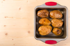 Baked potatoes in tray with copy space Royalty Free Stock Photos