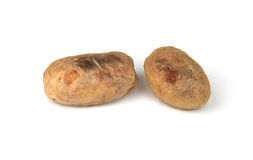 Baked potatoes. Two sweet baked potatoes on white background Royalty Free Stock Image