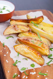 Baked potatoes. Vertical, close up Stock Photography