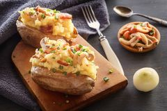 Free Baked Potatoes With Bacon And Mushrooms In A Rustic Way On A Wooden Board. Stock Photo - 138363880