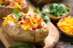 Free Baked Potatoes With Cheese And Bacon Stock Image - 118021971