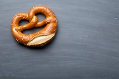 Baked pretzel on a chalkboard Stock Photos