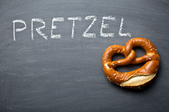Baked pretzel on a chalkboard Royalty Free Stock Image