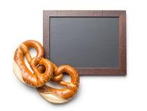 Baked pretzel and chalkboard Stock Image