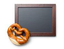 Baked pretzel and chalkboard Stock Photography