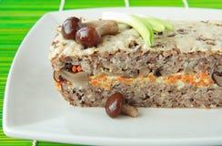 Baked pudding of buckwheat with mushrooms Stock Photo