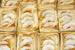 Baked puff pastry. Puff pastry with apples and jam Stock Images