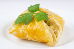 Puff pastry. Baked puff pastry with filling on white dish Royalty Free Stock Images
