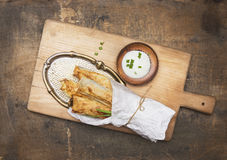 Baked puff pastry pies in cone of paper on old Metal tray Stock Photography