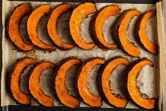 Baked pumpkin on a baking sheet, is ready royalty free stock photography