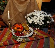 Baked pumpkin with bouquet of chrysanthemums. Baked pumpkin cut open, traditional Great Lent holiday food, popular in Eastern Europe, with bouquet of stock images