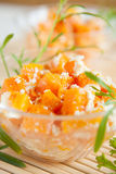 Baked pumpkin with cheese in clear glass bowls Stock Photography