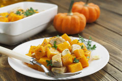 Baked pumpkin with chicken. garlic and herbs Royalty Free Stock Photography