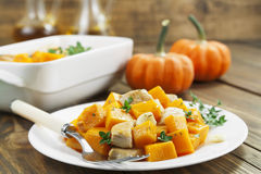 Baked pumpkin with chicken. garlic and herbs Stock Photo