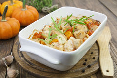 Baked pumpkin with chicken. garlic and herbs Royalty Free Stock Images