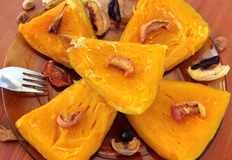 Baked pumpkin with dried fruits and nuts Royalty Free Stock Photography