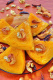 Baked pumpkin with dried fruits and nuts Stock Images