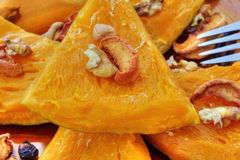 Baked pumpkin with dried fruits and nuts Royalty Free Stock Photo