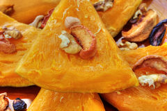 Baked pumpkin with dried fruits and nuts Royalty Free Stock Images