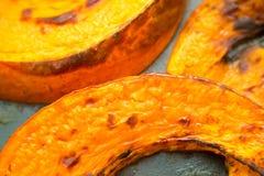 Baked pumpkin. Fried pumpkin on a baking sheet Stock Image