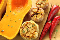 Baked pumpkin and garlic Royalty Free Stock Images