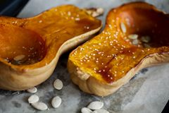 Baked pumpkin with honey and sesame for Halloween. Thanksgiving food. Close up. Baked pumpkin with honey and sesame for Halloween. Thanksgiving food. Healthy royalty free stock photography