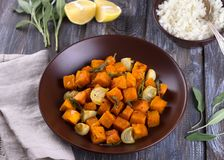 Baked pumpkin with onions, garlic and sage with boiled rice royalty free stock photography