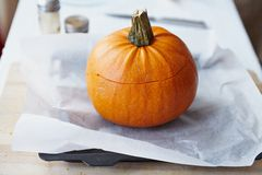 Baked Pumpkin with Rice and Fruits Stuffing Stock Photo