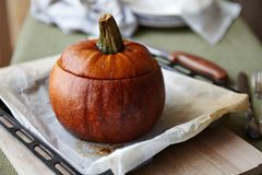 Baked Pumpkin with Rice and Fruits Stuffing Royalty Free Stock Image
