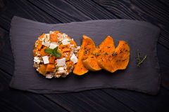Baked pumpkin salad with green buckwheat and feta cheese Stock Photography