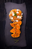 Baked pumpkin salad with green buckwheat and feta cheese Royalty Free Stock Photo
