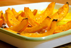 Baked pumpkin slices arranged with potato. Baked pumpkin slices in a shape of gondola arranged with potato and french salt grains Stock Photography