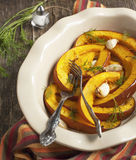 Baked pumpkin slices with garlic Royalty Free Stock Photos