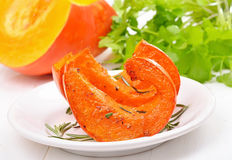 Baked pumpkin slices on white plate Stock Photography
