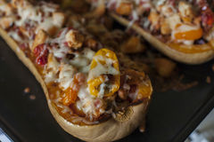 Baked pumpkin stuffed with meat, yellow bell pepper and mozzarella Royalty Free Stock Photos