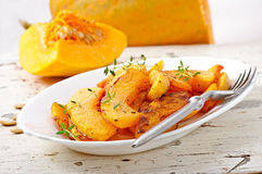 Baked pumpkin with thyme. On plate Royalty Free Stock Image