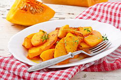 Baked pumpkin with thyme Stock Photos