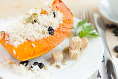 Baked Pumpkin With Rice And Raisins