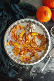 Baked pumpkin wrapped in bacon with rosemary and garlic. In a metallic baking pan royalty free stock photography