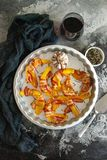 Baked pumpkin wrapped in bacon with rosemary and garlic. In a metallic baking pan royalty free stock images