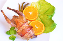 Baked quail. Quail baked with smoked bacon Stock Images