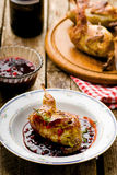 The baked quails with cowberry sauce Stock Images