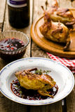 The baked quails with cowberry sauce Stock Photography