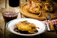 The baked quails with cowberry sauce Royalty Free Stock Photos