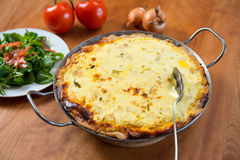 Baked quiche with field salad Royalty Free Stock Images