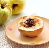 Baked quince with Circassian walnut Royalty Free Stock Photo